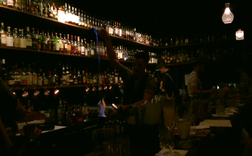 Barman makes a flaming rum drink at Eau de Vie in Melbourne March 2015.
